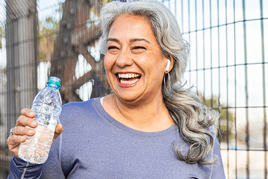 Woman drinking bottled water | Denver Health